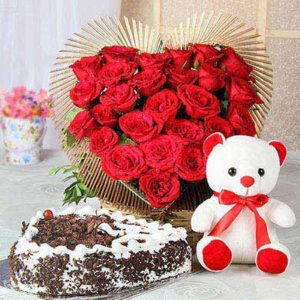 1-5-kg-heart-shaped-black-forest-cake-25-red-roses-with-teddy-14542-m